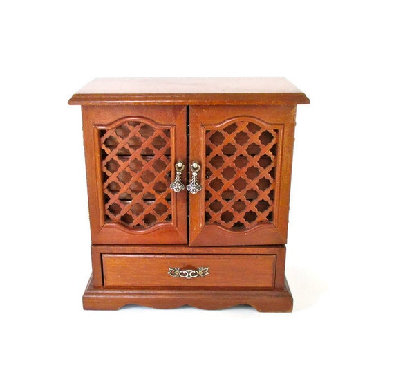 Vintage solid wood jewelry armoire with lattice doors and blue