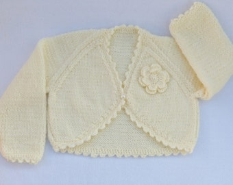 Knitted baby sweater. Hand knitted cream baby bolero cardigan to fit 6 to 12 months baby, baby clothes, baby shower, baby gift.