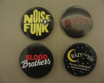 Theatre pin backs from four different Broadway shows