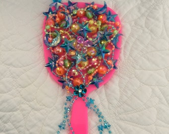 Upcycled hand mirror with lots of sparkle