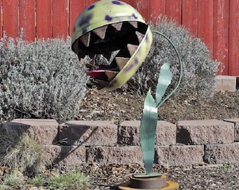 Weber the Venus flytrap welded salvage materials garden art.
