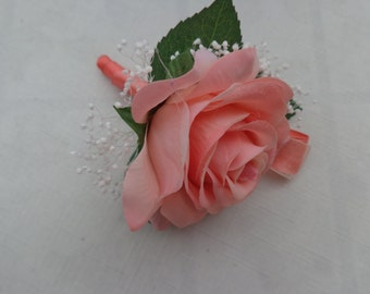Boutonniere designed with a coral real touch rose