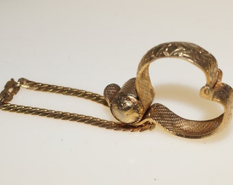 Embossed Gold Tone Glove Clip