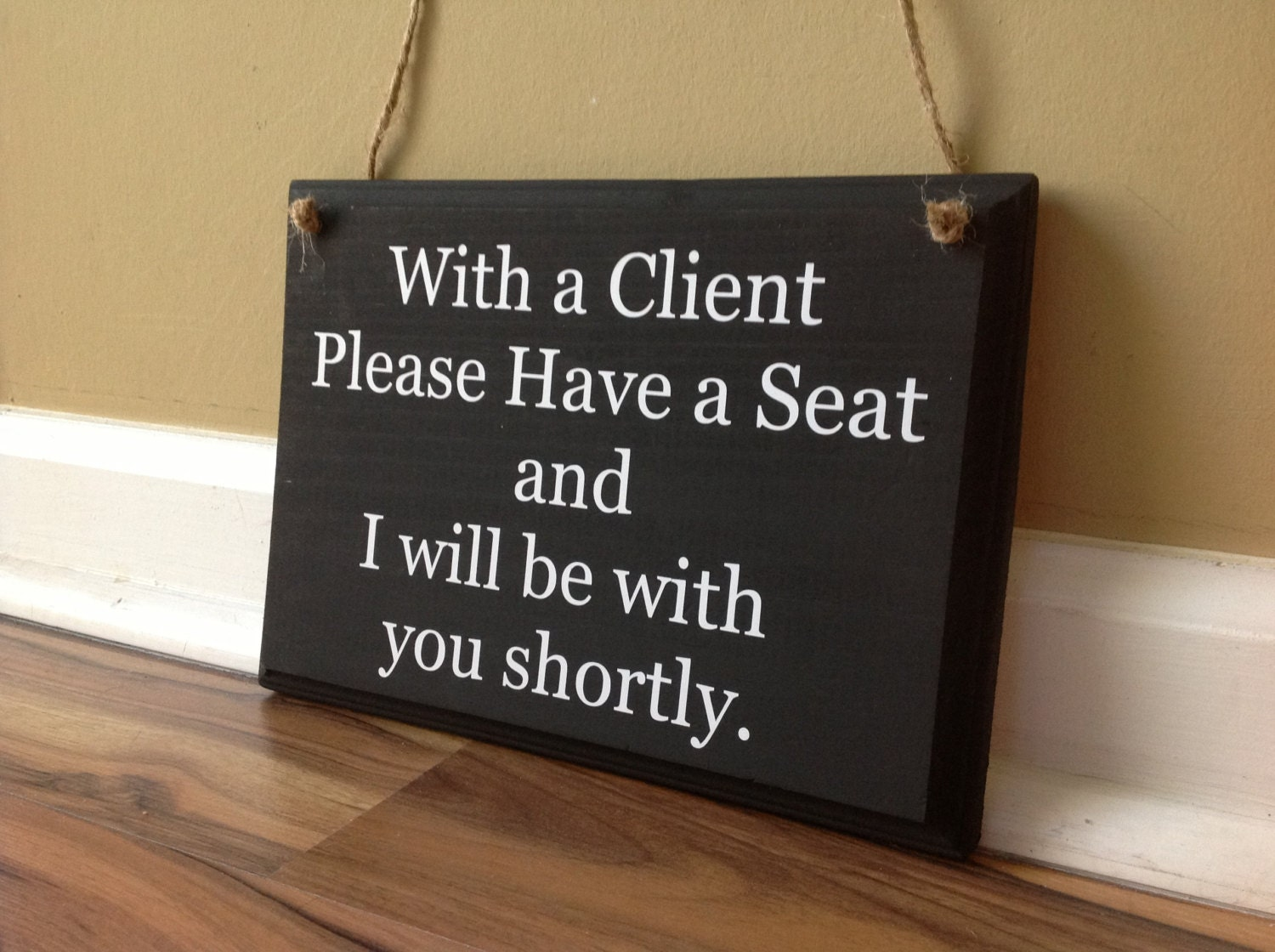 With A Client Please Have A Seat And I Will Be With You