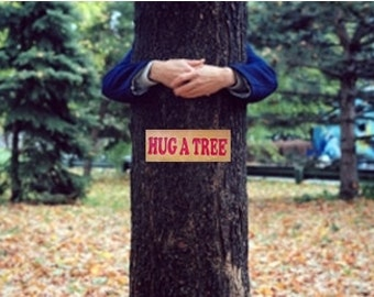 Tree hugger sign, HUG A TREE handmade on quarter-sawn old growth Douglas fir, this is recycled scrappy wood that a tree lover can love