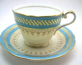Aynsley Turquoise Blue & Ivory Tea Cup And Saucer, English Fine bone china, Blue and gold tea cup set.
