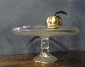 Glass pedestal cake plate: Jeannette harp