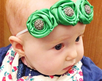 Trio of satin rosettes. Rolled fabric flowers