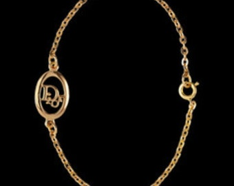 """Authentic Christian Dior Symbol Bracelet Gold Plated Chain with """"Dior"""" Emblem in Center 4 grams"""