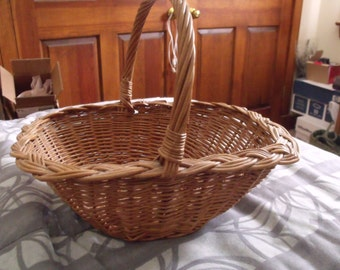 Wicker basket, vintage, hand made..sturdy, good shape.