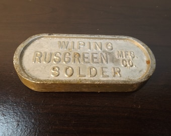 Metal Alloy Lead oval marked : Rusgreen,MFG.co.wiping solder. paper weight Gift