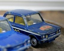 Vintage Corgi Hillman Imp cars displayed in stunning glass dome