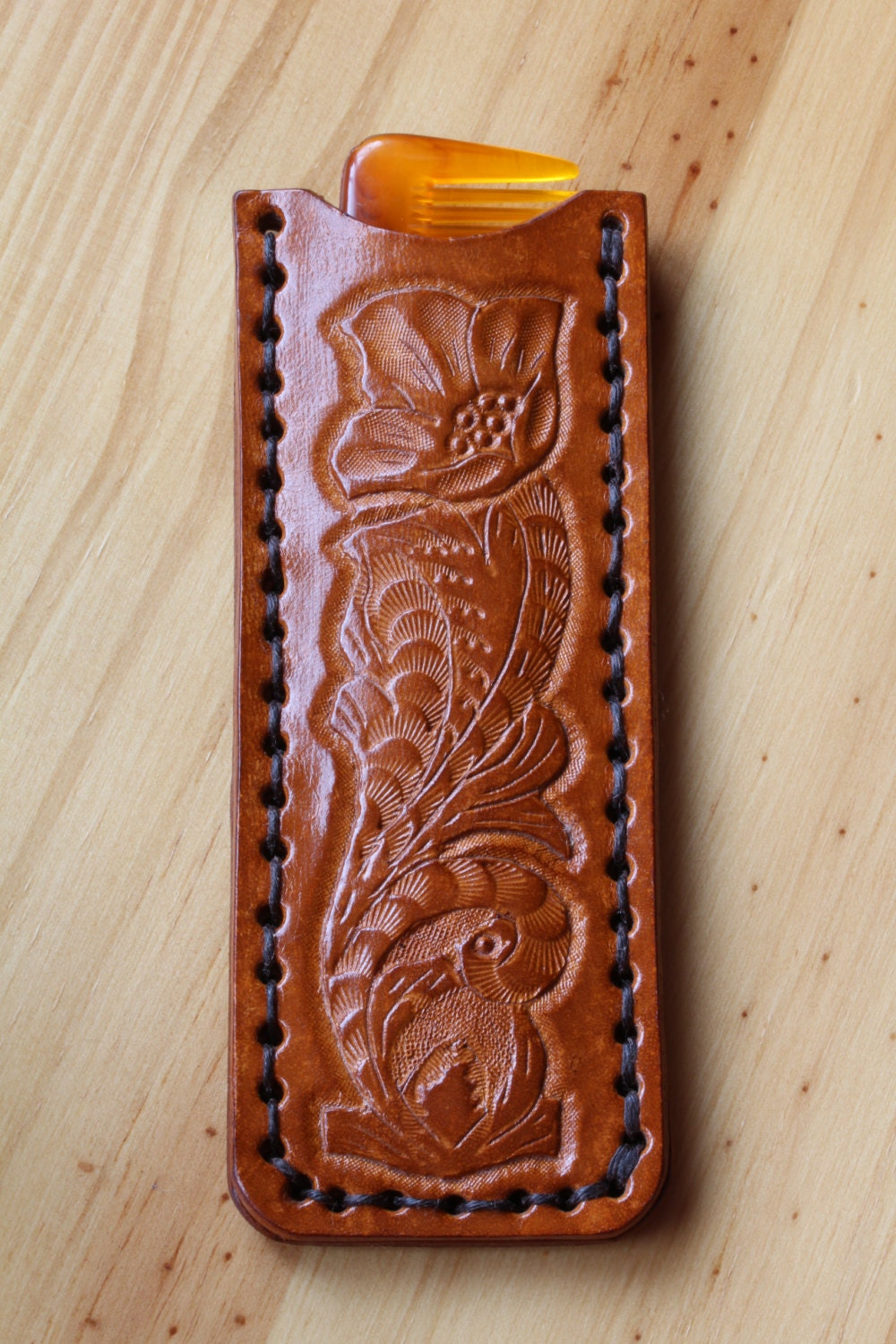 Hand carved leather pocket comb case personalised