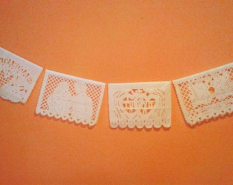 "3 Papel picado for wedding, in white color with the phrase ""NUESTRA BODA"""