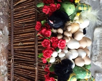 Easter Basket with Flowers and Eggs