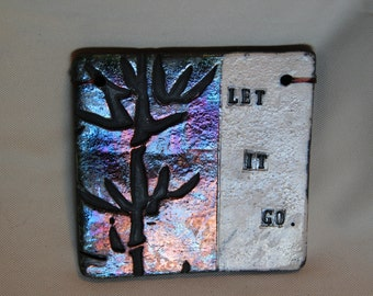 "Clay Quote Tile "" Let It Go"" with sigilated bambo motif, Raku varied colors contrast with white background. Black smoke lettering."