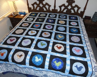one of a kind quilt in blues and black cotton with birds, approx 69x83 in