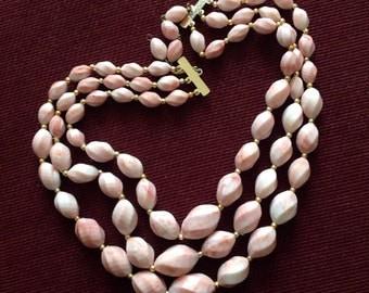 Pink fancy shape 3 row bead necklace