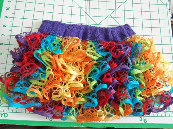 Baby or Toddler ruffled skirt. Multicolor with purple waistband.