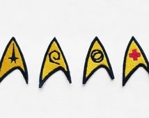 Insignias for Kirk, Spock, Scotty, Dr. McCoy
