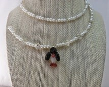Penguin necklace  & earring set made with Swarovski crystal , pearls on wire !