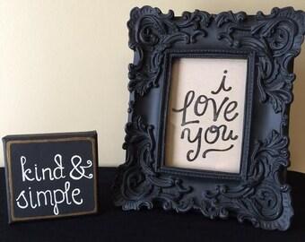 "Framed ""I love you"" print in black baroque frame"