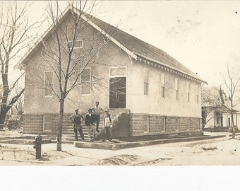 1910 Vintage RPPC Postcard of Workers Standing Outside A Building