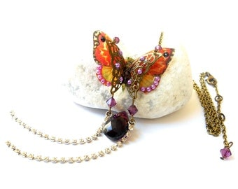 Pendant necklace handmade transparent butterfly on rhinestones and Swarovski crystal