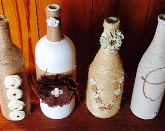 """Reclaimed wine bottle crafts made into """"l"""" """"o"""" """"v"""" """"e"""" home decor vase made from string, jute, twine, paint, and/or burlap"""