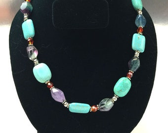 Turquoise and Florite Necklace with Orange Swarvoski Crystals and sterling silver beads.