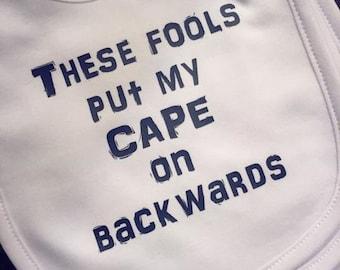 These fools put my cape on backwards bib!