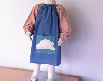 childrens art smock with a padded cloud image, pocket