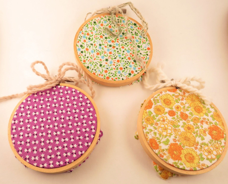 Three fabric art embroidery hoop hanging