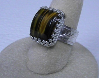 This ring is a very nice tiger eye size 6  1/2.