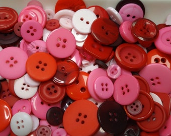 Mixed buttons, 50g bag, various sizes & shades of pink / red. Great for a variety of crafts.