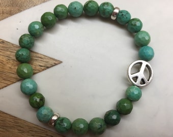 Turquoise beaded bracelet with peace sign detail