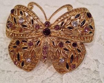Gold Tone Three Dimensional Butterfly Brooch with Amethyst and Clear Rhinestones in Filigree Setting.