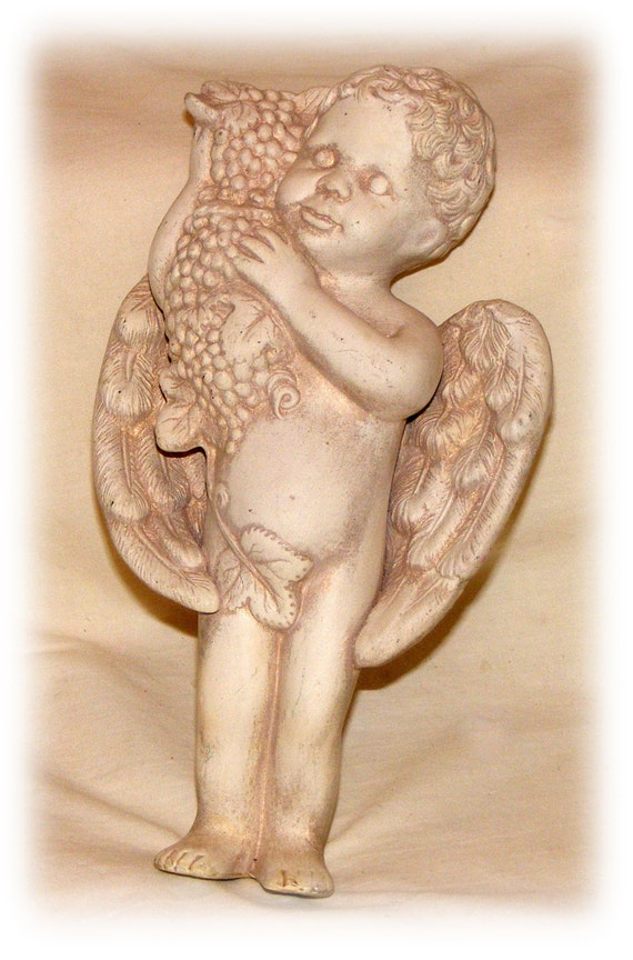 PORCELAIN BISQUE FIGURINE. Cherub Angel With Grapes