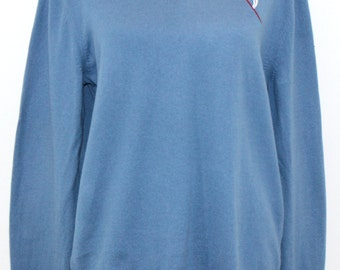 Slate blue cashmere cotton sweater embroidered with abstract flower design.