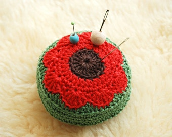 Crochet pincushion made in red,green and brown with flower motif -poppy - sewing - ringcushion - dollhouse cushion