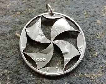 Pinwheel design half dollar hand cut coin