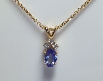 14k yellow gold tanzanite and diamond pendant with chain; 6 x 4 mm oval tanzanite, 1.9 grams; All occasion gift.
