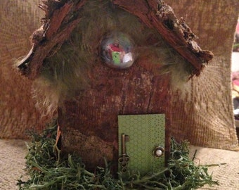 RIver Birch bark fairy house with feathers and moss