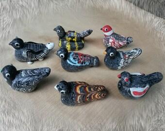 Phoenician glass bird beads
