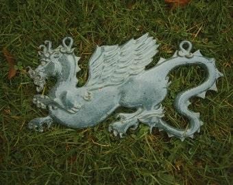 Stoneware dragon wall plaque in sea green glaze  30cm x 20cm approx