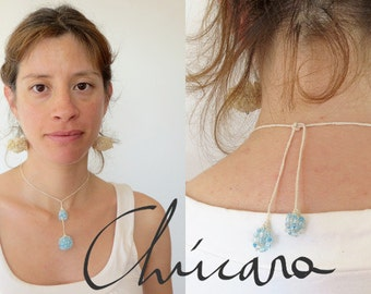 Necklace, crocheted with cotton thread and light blue beads