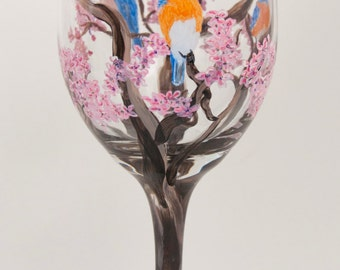 Bluebirds on lilac tree branches, Hand painted wine glass, spring scene