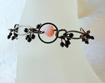 Pink Peruvian opal and black chain bracelet