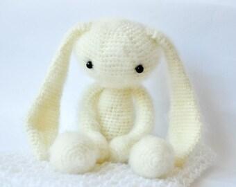 Big crochet hare with a long ears. Crochet toy rabbit. Stuffed toy.
