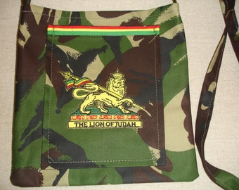 Camouflage water resistant fabric bag,trimmed with red,gold and green and the lion of judah